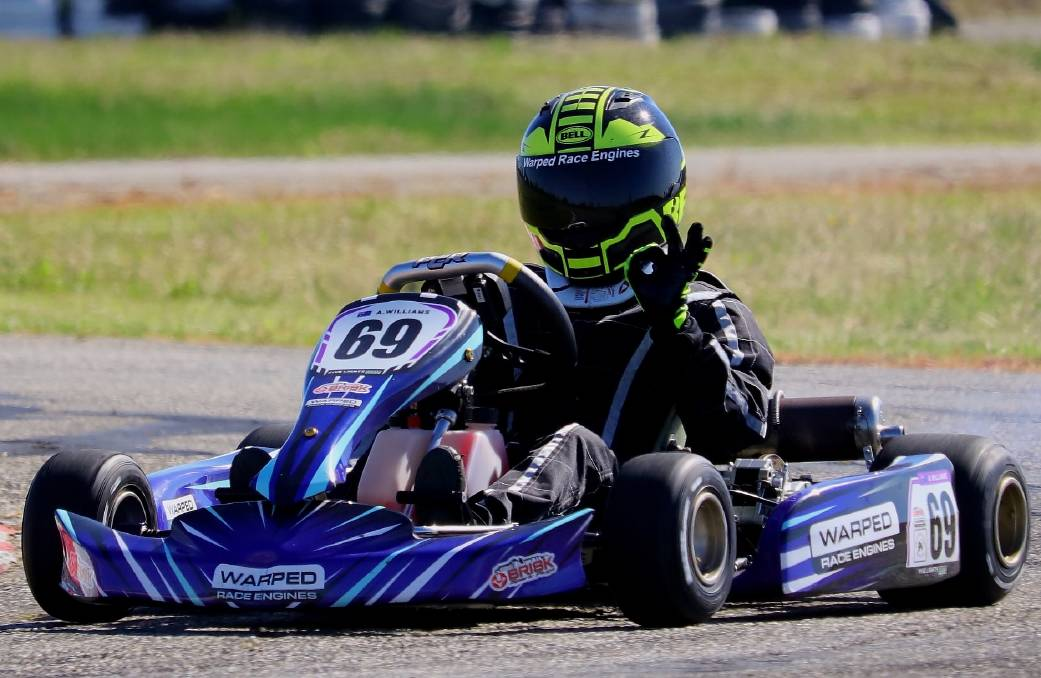 Out in front: Moruya kart racer Aidan Williams signals a successful run after racing to a win in the Southern Stars opening round at Wagga Wagga. Picture: five lights photography